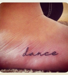 Black line dancer tattoo