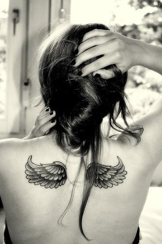 Black looking wings tattoo