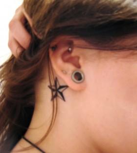 Black lovely stars girl's ear tattoo