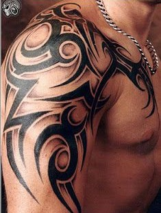 Black ornaments of men's shoulder tattoo
