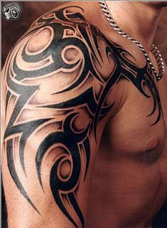 Black ornaments of men's shoulder tattoo