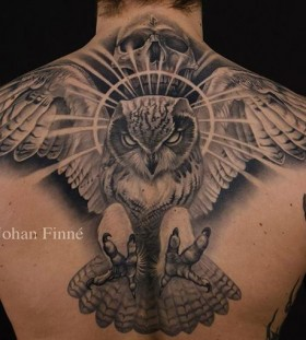 Black owl men's back tattoo