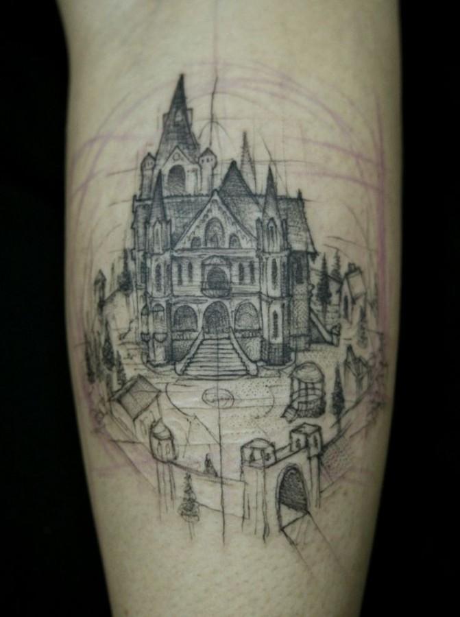 Black painted castle tattoo