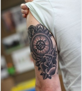 Black rose and compass tattoo