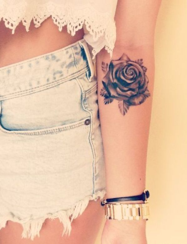 Black rose placement tattoo
