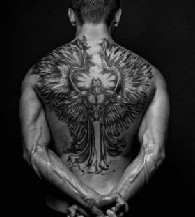 Black shoulder and back men's back tattoo
