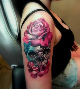 Black skull and pink rose tattoo