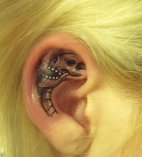 Black skull girl's ear tattoo