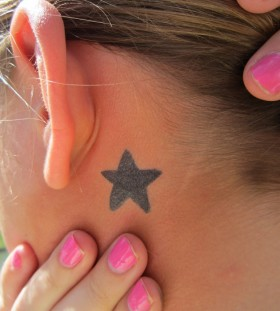 Black stars and pink nail girl's ear tattoo