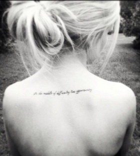 Blonde girl back quote tattoo