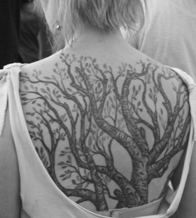 Blonde girl's black tree tattoo