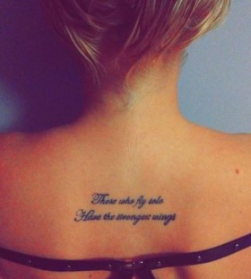 Blonde girl's quote tattoo