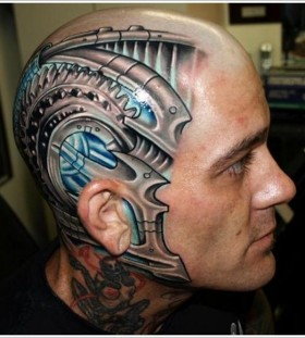 Blue and black tattoo on head