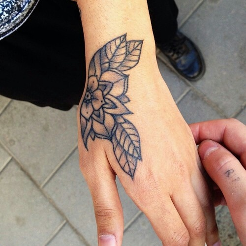 Blue arm flower tattoo