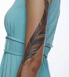 Blue dress and feather tattoo