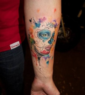 Blue eyes watercolor skull tattoo