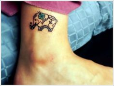 Blue small flower and elephant tattoo
