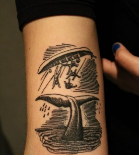 Capsized boat tail whale tattoo