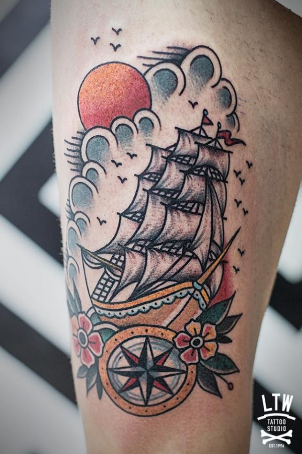 Clouds and sun ship tattoo