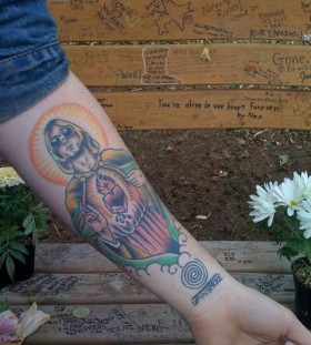Colorful arm nirvana tattoo