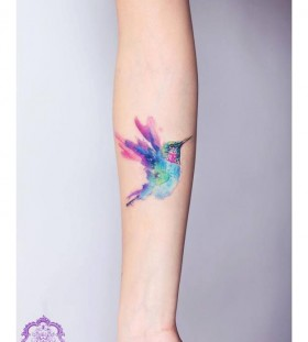 Colorful bird tattoo by Candelaria Carballo