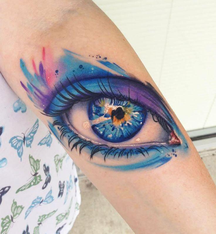Colorful blue eye tattoo