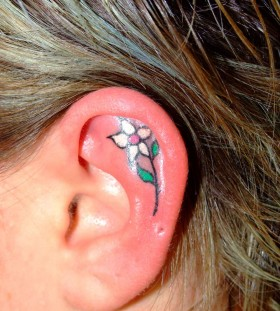 Colorful flower girl's ear tattoo