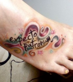 Colorful foot and accio tattoo
