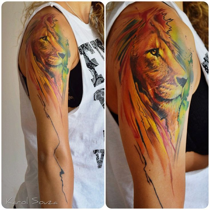 Colorful girl's arm's lion tattoo