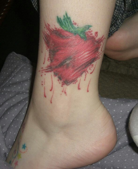 Colorful red strawberry tattoo