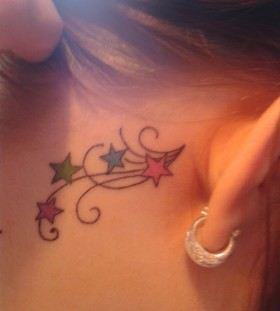 Colorful stars girl's ear tattoo