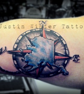 Compass and snow with winter tattoo