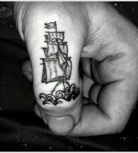 Cool finger ship tattoo