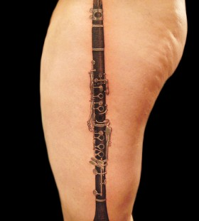 Cool lookink clarinet tattoo
