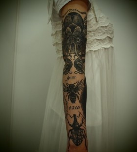 Cool octopus and bee tattoo on arm