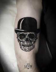 Cruel simple black skull tattoo