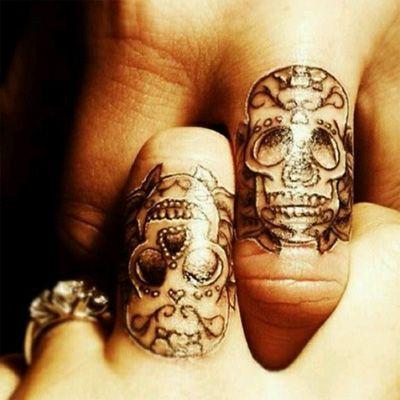 Cruel skull couple tattoo