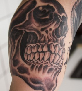 Cruel teeth and skull tattoo