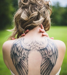 Curly blond angel tattoo