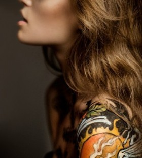 Curly girl hair and swan tattoo