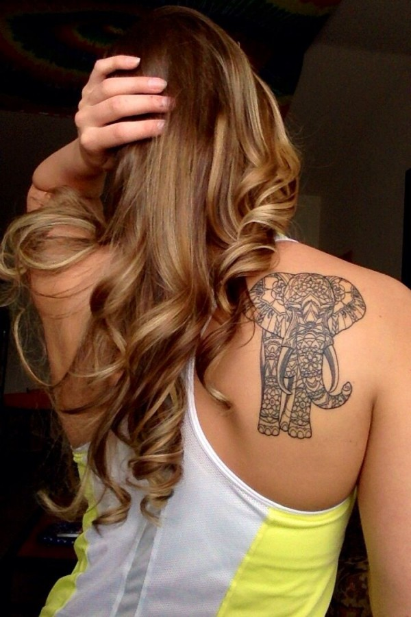 Curly girl's hair and elephant tattoo