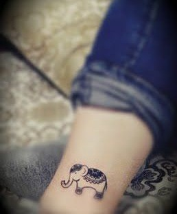 Cute black elephant tattoo