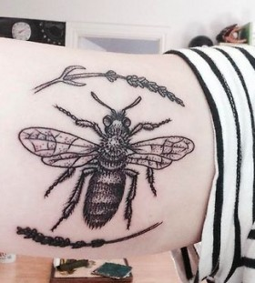 Cute leaf and bee tattoo on arm