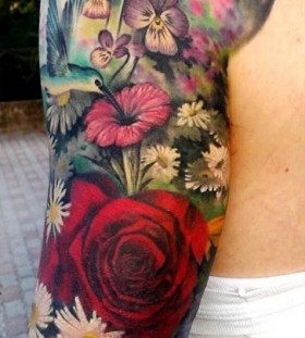 Different flowers men's arm tattoo