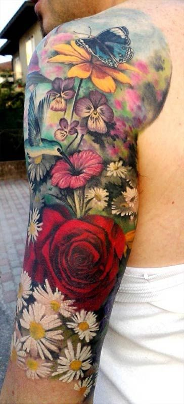 Different flowers men's arm tattoo