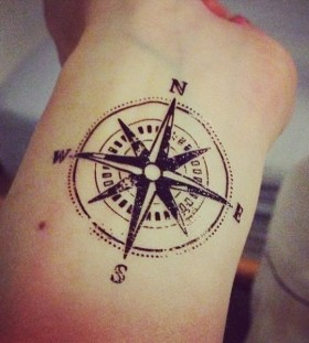 Different sides compass tattoo