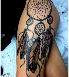 Dreamcatcher and black feather tattoo