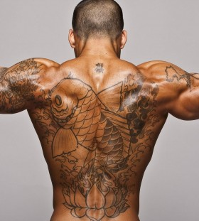Fish and strong men's back tattoo