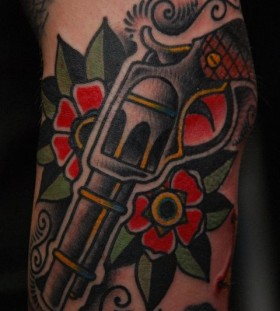 Flower and gun American Traditional Tattoo