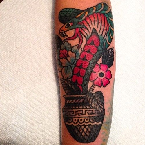 Flowers and snake tattoo by Austin Maples